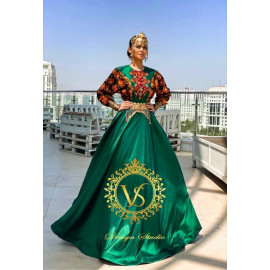 "Designer dress in emerald color from the ""Autumn 2020"" collection"